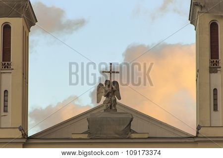 Beautiful decoration Crying Angel with a cross on the top of The Lutheran Church of Saint Peter and Saint Paul on the background of a beautiful sky. Located in Saint-Petersburg Nevsky 22-24 poster