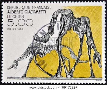 FRANCE - CIRCA 1985: a stamp printed in France shows The Dog Abstract by Alberto Giacometti