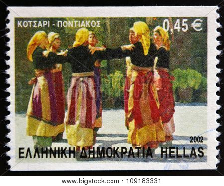 GREECE - CIRCA 2002: A stamp printed in Greece dedicated to Greek Dances shows Kotsari dance Pontian