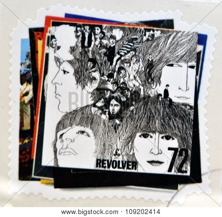 a postage stamp printed in Great Britain showing an image of The Beatles Revolver album cover