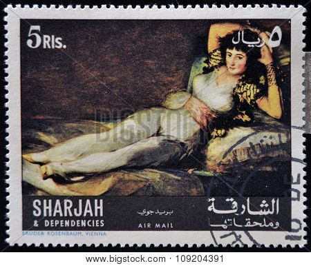 SHARJAH - CIRCA 1980: A stamp printed in Sharjah shows The Clothed Maja by Francisco de Goya