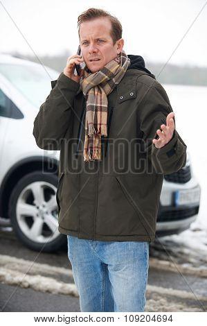 Motorist Broken Down In Snowy Countryside