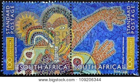A stamp printed in RSA shows mural on the faculty of health sciences University of Cape Town
