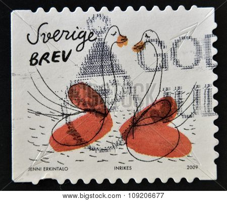 SWEDEN - CIRCA 2009: stamp printed in Sweden shows Swans and hearts circa 2009