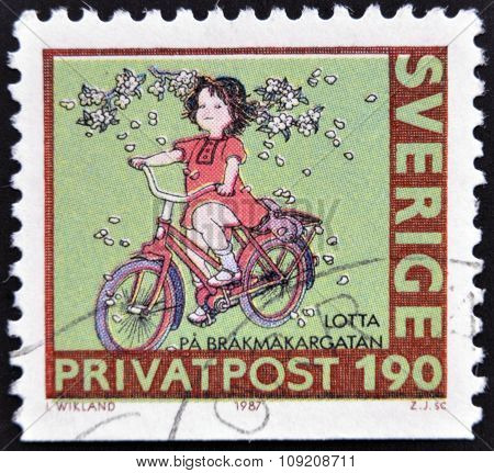 SWEDEN - CIRCA 1987: stamp printed in Sweden shows Girl on bike circa 1987