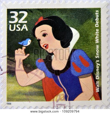 A stamp printed in USA commemorative of the Snow White movie debut