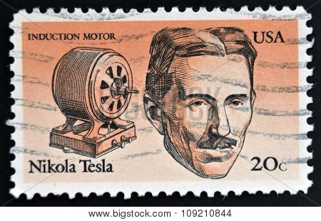 stamp printed in USA shows Induction motor and portrait of Nicola Tesla inventor electrical engineer