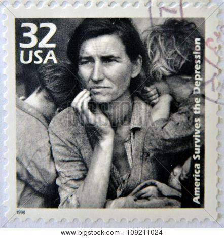 stamp printed in USA showing an image of a mother with her children during the Great Depression