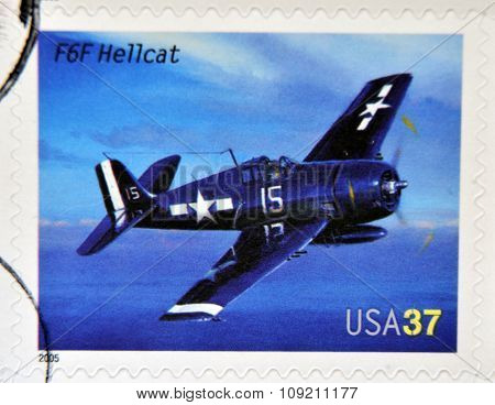 A stamp printed in USA dedicated to advances in aviation shows Grumman F6F Hellcat