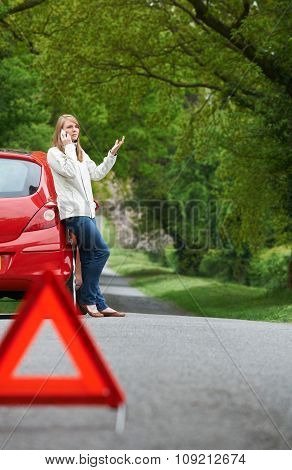 Female Motorist Broken Down On Side Of Road