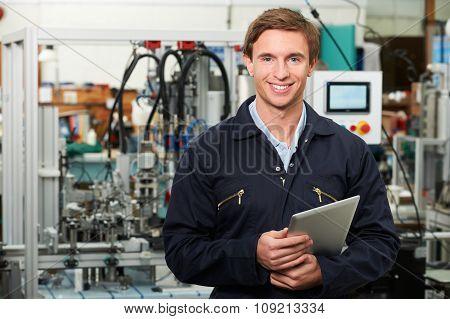 Engineer In Factory Holding Digital Tablet