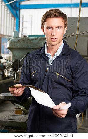 Factory Worker Reading Redundancy Letter