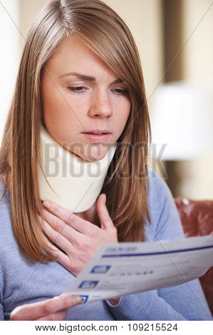 Young Woman Wearing Neck Brace Reading Letter