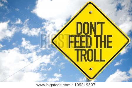 Don't Feed the Troll sign with sky background