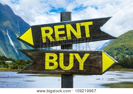 Rent - Buy signpost with mountains on background