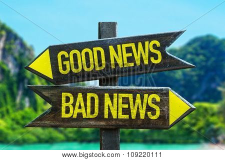 Good News - Bad News signpost in a beach background