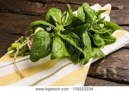 Spinach Leaves On A Wooden Background