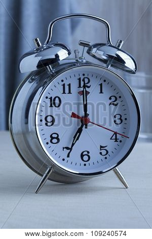 Traditional alarm clock at seven o'clock in the morning