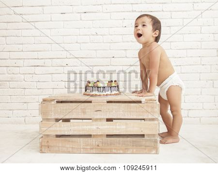 Cheerful Toddler And His Cake On Wooden Box