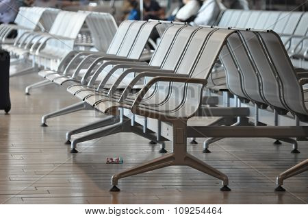 Row Of Empty Benches At An Airport