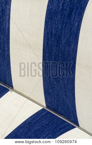 Detail Of  The Canvas Of The Beach Umbrella In Blue And White Stripes