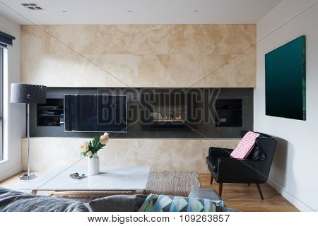 Living Room With Wall Mounted Tv And Gas Fireplace
