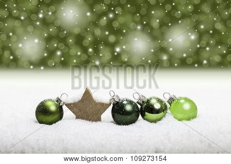 Row of green christmas glass balls in the snow