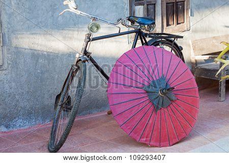 Retro Bicycle With Red Umbrella