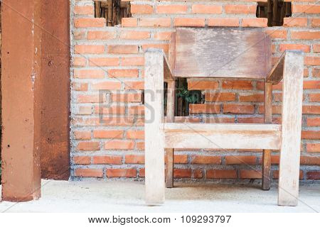 Wooden Chair With Red Bricks Wall