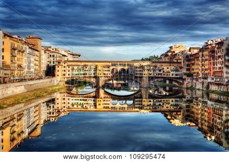 Ponte Vecchio bridge in Florence, Italy. Arno River. Tuscany under dark, stormy clouds poster