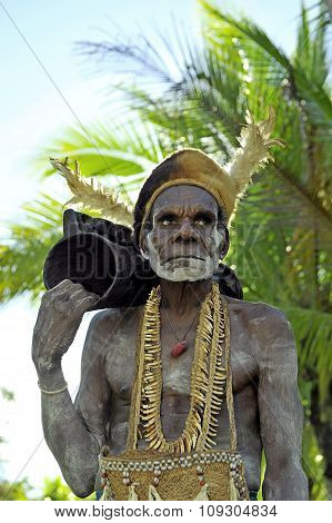 Asmat Tribesman With Drum.the In The Village Of Asmates Goes Preparation For Of A Ceremony Of Doroe.
