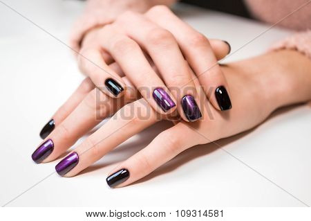 Hand on hand with nice manicure