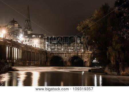 Pulteney Bridge and weir at night, in Bath, UK