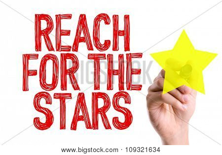 Hand with marker writing: Reach For The Stars