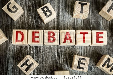 Wooden Blocks with the text: Debate