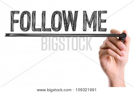 Hand with marker writing: Follow Me