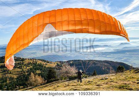Paraglider Is Starting  To Start His Flight.