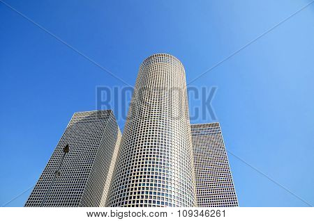 Azrieli Center in Tel Aviv on a clear blue sky. The round building