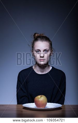 Girl Sitting In Front Of Apple