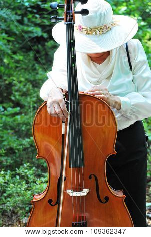 Mature female cellist.