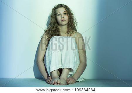 Miserable Girl On The Floor