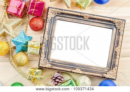 Vintage Blank Photo Frame With Christmas Decorations.