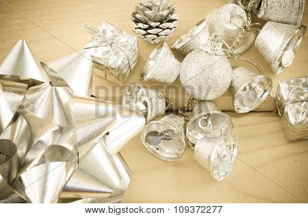 Silver Bell And Silver Ribbon In Vintage Background.