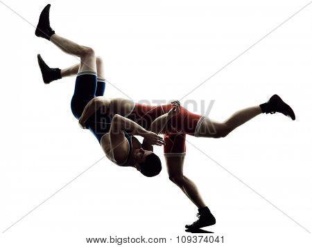 two caucasian wrestlers wrestling men on isolated silhouette white background
