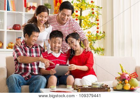 Family With Tablet Computer