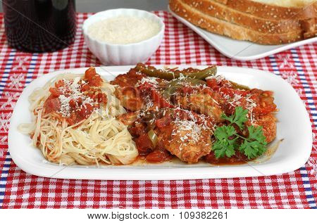 Chicken Cacciatore With Pasta And A Side Of Bread.
