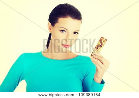 Happy young woman holding grain waffer.