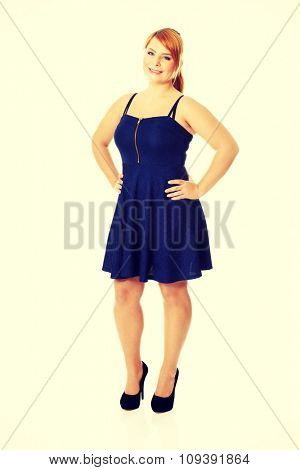 Happy plus size woman posing in skirt poster