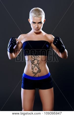 Portrait of a professional athlete woman bodybuilder with a perfect athletic physique. Fitness sports. Healthcare, bodycare. Martial arts, fighter. poster