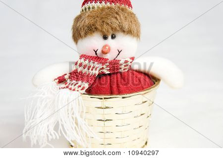 Snow Man Toy In A Golden Box Decoration Isolated
